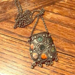 Grey metal pouch necklace with polished stones